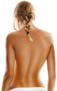 Back side view of a young, blonde woman's perfect body.